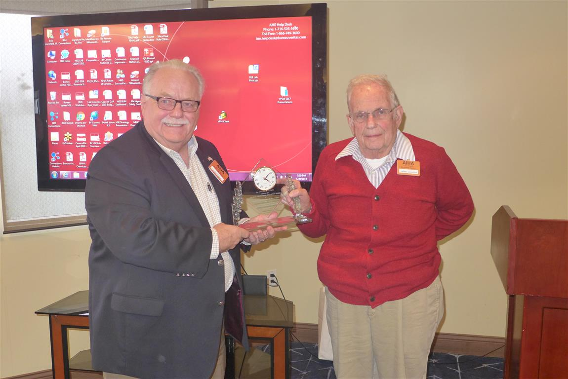 Harry Ettinger recieves Clayton Award from President Larry Gibbs